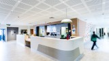 A long shot of the Werribee Mercy Hospital reception desk.